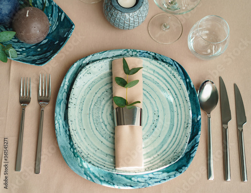 Luxury green table setting decorated with candles
