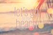 Leinwandbild Motiv Let's go to the beach words on blur tropical beach with bokeh sunlight wave abstract background.