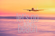 Leinwandbild Motiv Airplane flying with let's go to the beach words over blur tropical beach and sunset sky abstract background.