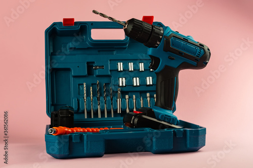 case with a screwdriver and nozzles on a pink background Fototapet