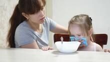 Mom Calms A Capricious Child S...