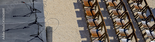 Open air stage with rows of chairs Wallpaper Mural