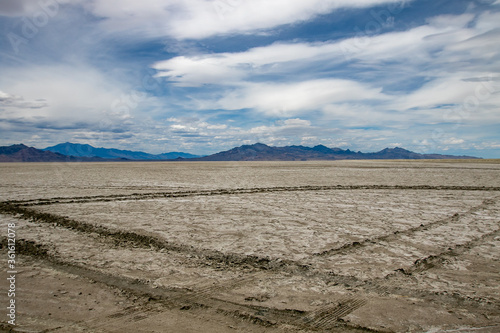 Landscape near Bonneville Salt Flats with tire tracks in the foreground. #361612078