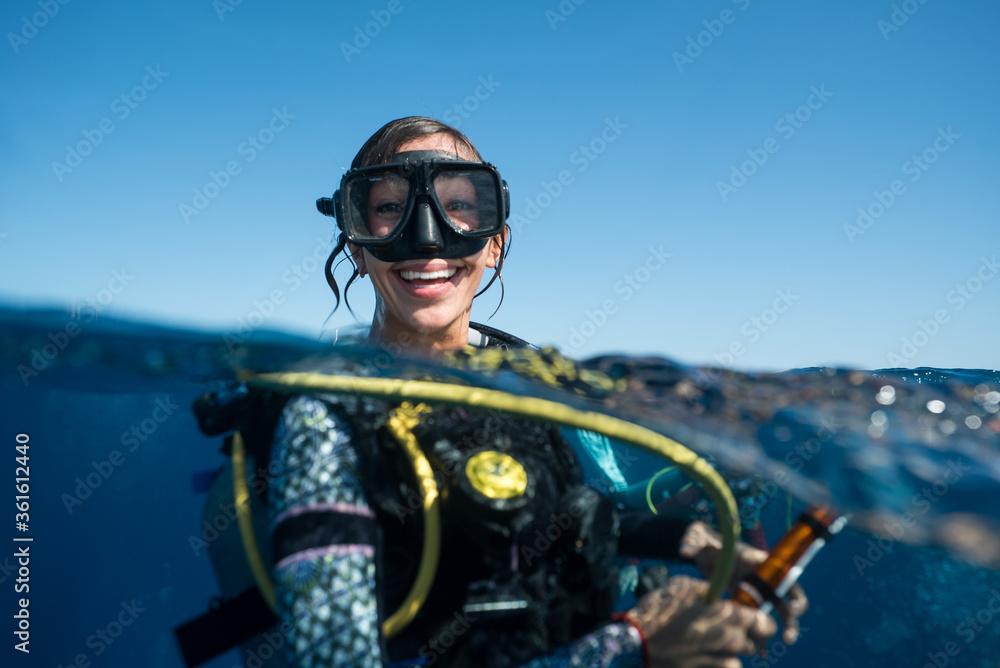 Fototapeta Woman SCUBA Diving Smiling in Ocean