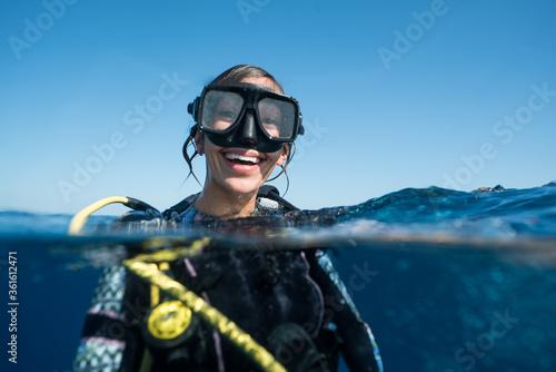 Woman SCUBA Diving Smiling in Ocean Fototapeta