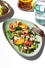 Fresh Healthy Summer Seafood Salad With Spinach, Avocado, Oranges And Feta Cheese On The White Table.
