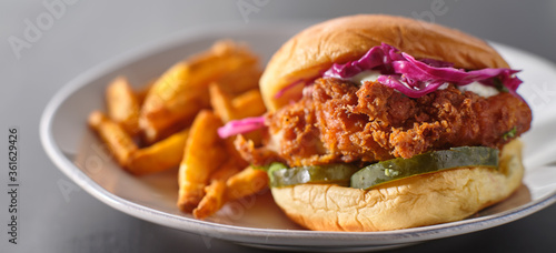crispy fried chicken sandwich on plate with fries