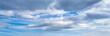 canvas print picture - Fluffy clouds in bluet sky panoramic view. Climate, environment and good weather concept sky background panorama.