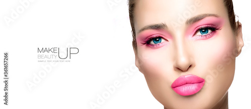 Obraz Beauty and Makeup Concept. High fashion model girl with bright pink makeup - fototapety do salonu