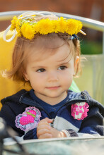 Child With Dandelion Corolla