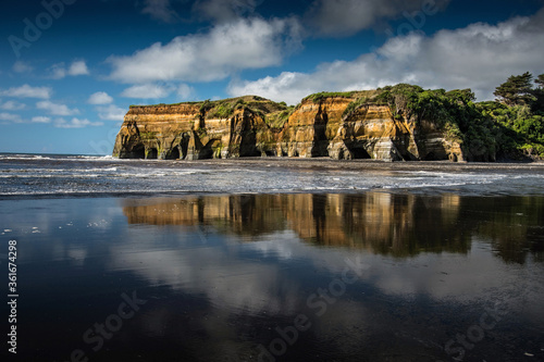 Three sisters beach with cliffs reflection, New Zealand Canvas Print
