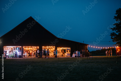 Night view of a party in a barn Fototapeta