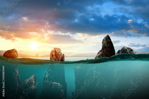 Half underwater in the sea a big rock Canvas Print