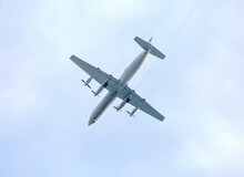 Turboprop Aircraft Flying Thro...