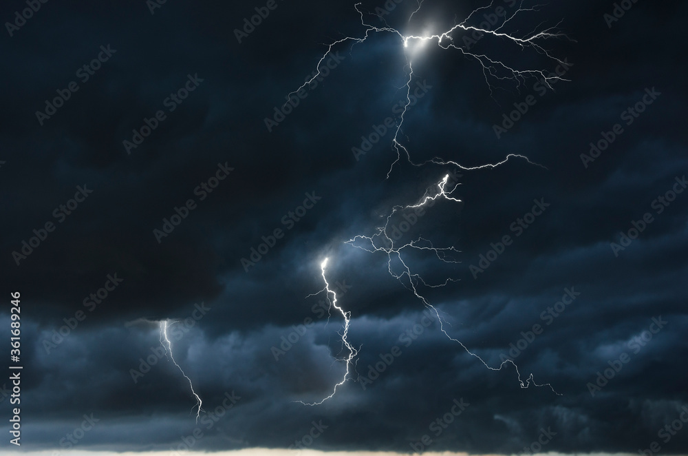 Fototapeta Strong thunder storm in black clouds