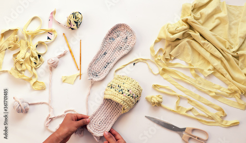woman recycle by cut clothes to make yarn ball for handmade sandals from old T s Wallpaper Mural