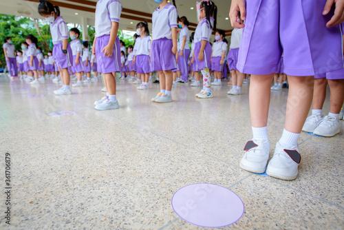 Picture of school children standing in line in kindergarten and standing spaced Wallpaper Mural