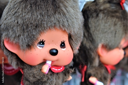 Closeup of a cute doll with ashen hair and freckled cheeks displayed in a store Canvas Print