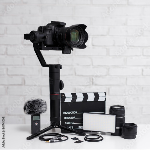 Fotografie, Obraz videography concept - modern dslr camera on 3-axis gimbal stabilizer, lenses, mi