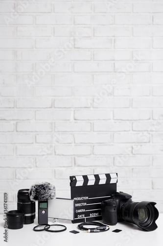 Vászonkép videography concept - modern dslr camera, lenses, microphone, led light, clapper
