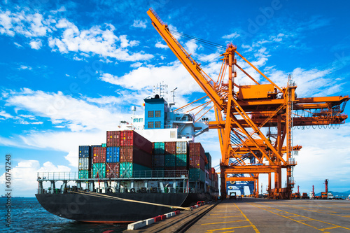 Huge Panamax size container vessel discharging and loading container cargo at port terminal Wallpaper Mural