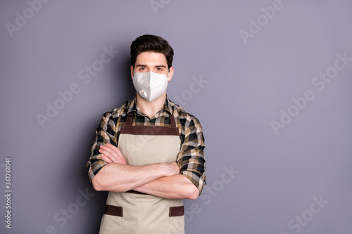 Portrait of his he attractive content serious guy folded arms wearing safety mask stop influenza contamination disease sickness illness china wuhan isolated grey color background