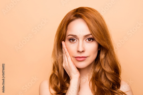 Close-up portrait of her she nice-looking attractive lovely sweet gentle shine wavy-haired lady touching cheek therapy treatment laser plastic surgery isolated over beige background