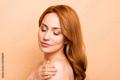 Close-up portrait of her she nice-looking sweet charming attractive nude naked pure shine perfect peaceful dreamy wavy-haired lady clean clear isolated over beige background