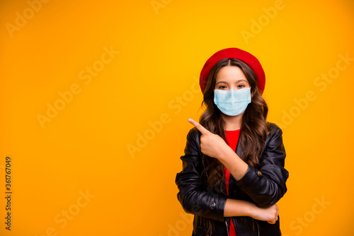 Portrait of attractive confident long-haired girl wearing safety gauze mask demonstrating tips news novelty mers cov infection copy space isolated bright vivid shine vibrant yellow color background