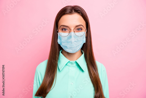 Close-up portrait of her she nice attractive intelligent straight-haired girl wearing gauze safety mask air pollution problem co2 influenza preventive measures isolated pink color background