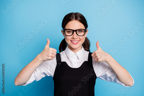 Close-up portrait of her she nice attractive pretty charming smart clever knowledgeable cheerful cheery schoolgirl showing thumbup isolated on bright vivid shine vibrant blue color background