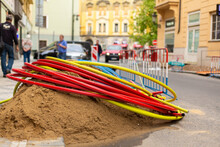 Repair Work On City Streets. Laying Cable Routes. Coils Of Plastic Casings