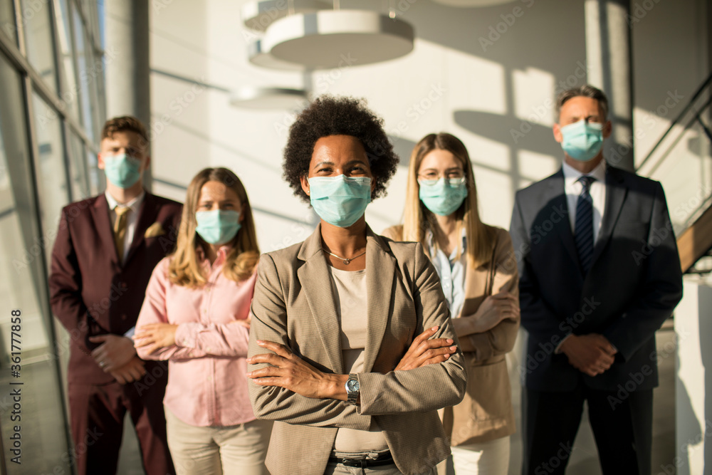 Fototapeta Group of asian business people standing in office and wear mask for protect prevent infection by corona virus