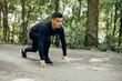 Leinwandbild Motiv Handsome man in a park. Sportsman in a sportswear. Guy training