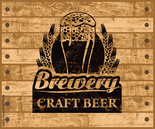 Canvastavla Label or banner for craft beer with overflowing glass of frothy beer, ears of wheat and inscriptions on background of wooden planks