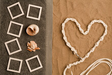 Concept Photo Beach Memories Collage Photo Frames Mockup On Gray Towel With Shells. Beach Sand With Nautical Lines Heart Shape. Top View. Space For Textconcept Photo Beach Memories Collage Photo Frame