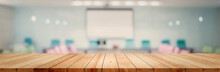 Panoramic Empty Clean Wood Counter Table Top On Blur Student Study In Classroom White Light Background For Product Education Learning Hall Centre, Abstract Blurry Wooden Desk Scene Display Or Montage.