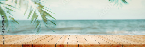 Fotografering Panoramic empty clean wood counter table top blur shinny white bokeh light on summer beach background for product morning scene display montage, Abstract Blurry wooden desk in vacation trip backdrop