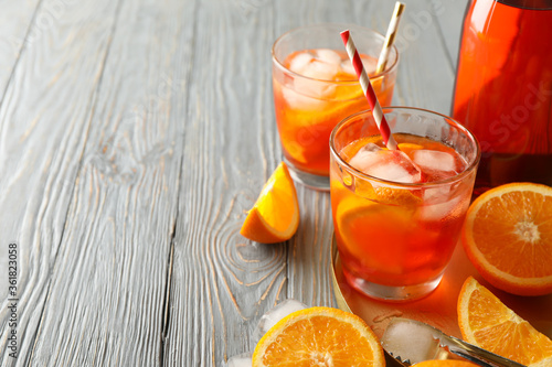Composition with aperol spritz cocktail on wooden background. Summer drink