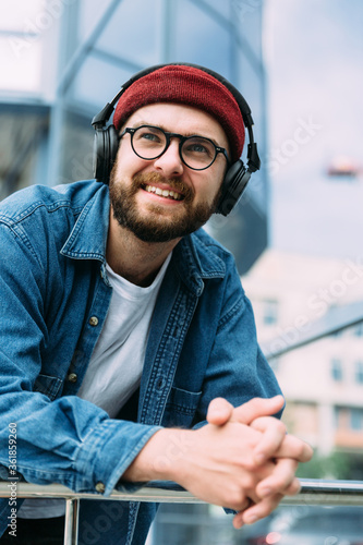 Closeup vertical portrait of happy cheerful bearded handsome male hipster enjoyi Canvas
