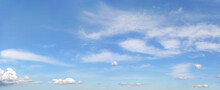 Bright Sky Background With Few Cirrus Clouds Above And Small Ones In Lower Part
