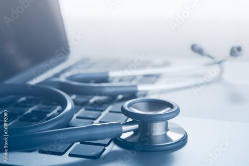 Fototapeta Stethoscope on laptop computer for medical technology telemedicine and medical online concept obraz