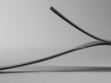 Abstract Of Two Forks With A S...