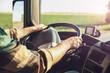 Leinwanddruck Bild - Young man driving modern truck