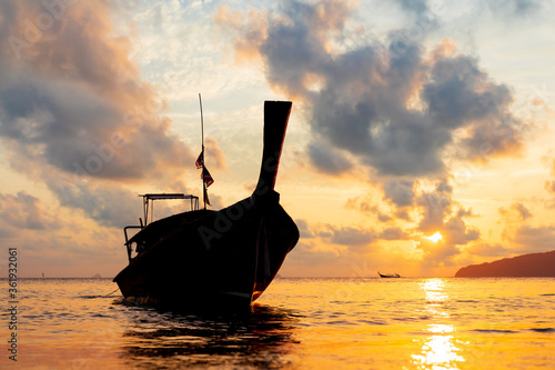 Traditional long-tail boat on the beach in Thailand at sunset Fototapet