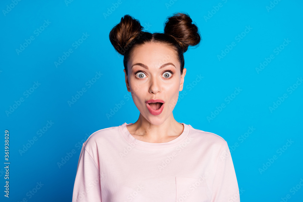 Fototapeta Closeup photo of attractive pretty shocked lady two funny buns cheerful mood listen amazing good news wear casual white pink t-shirt isolated bright blue color background