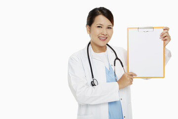 Medical personnel smiling and holding up a blank clipboard