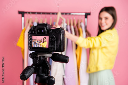 Photo of pretty lady broadcast online internet blog episode show new clothes collection blurry focus cadre wear yellow leather jacket skirt isolated pastel pink color background