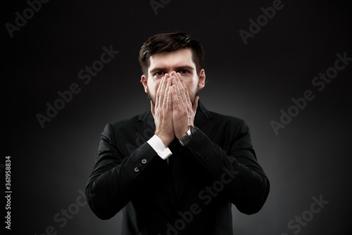 Valokuvatapetti Man gesture showing stress and fright, covering face