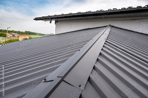 . Gutter system for a metal roof. Holder gutter drainage system on the roof. Fototapet